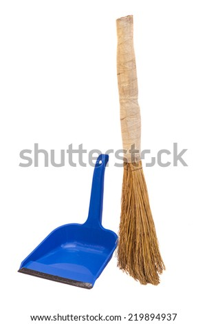 blue plastic dustpan and straw broomstick  - stock photo