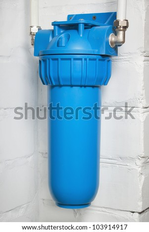 Blue plastic filter housing for water purification - stock photo