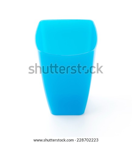 blue plastic glass on white - stock photo