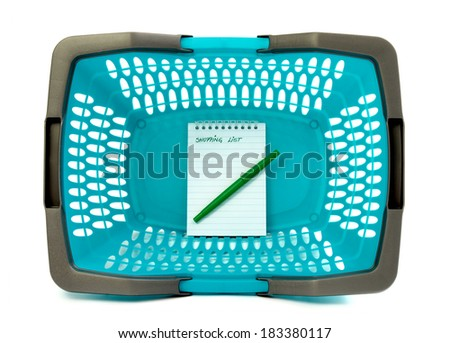 Blue plastic shopping basket with blank shopping list isolated on white.Close up on empty plastic market basket and a notebook. - stock photo