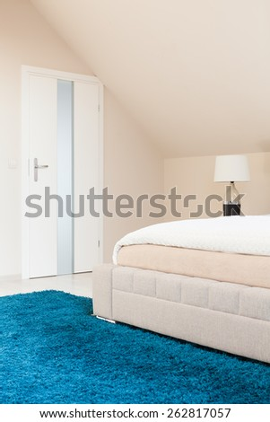 Blue plush carpet in beauty pastel bedroom - stock photo