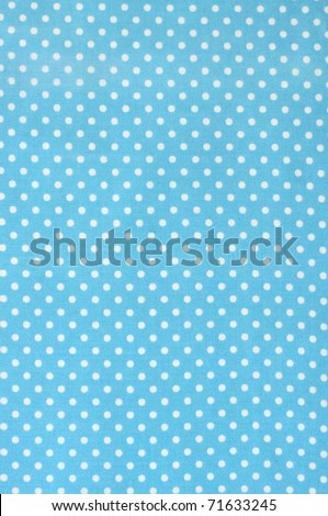 Blue polka dot fabric - stock photo