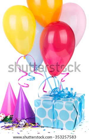 Blue polka dot present with birthday hats and balloons on a white background - stock photo