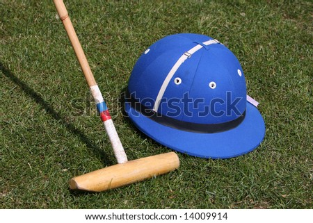 Blue Polo hat and mallet - stock photo