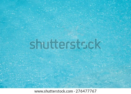 Blue pool water ripples. Texture of background - stock photo