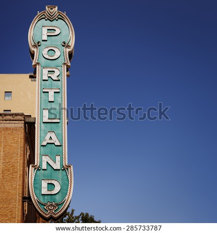 Blue Portland sign from 30's on brick building in Portland, Oregon, USA with clear blue sky and free copy space for your text - stock photo