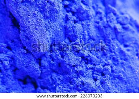 Blue powder color closeup on HOLI a color festival of India - stock photo