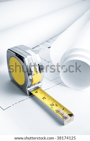 Blue Prints with Measuring Tape - stock photo