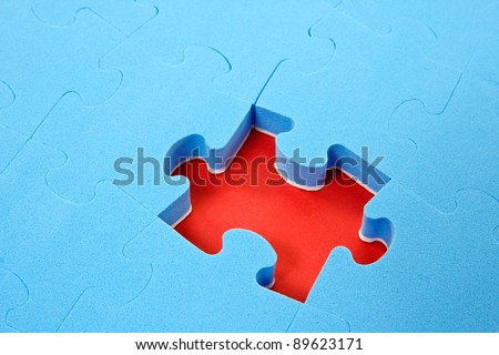 blue puzzle background with one piece missing - stock photo