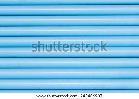 Blue pvc pipes in line for background texture - stock photo