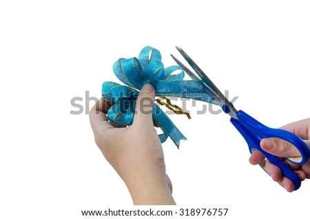 Blue ribbon cutting isolated on white background - stock photo