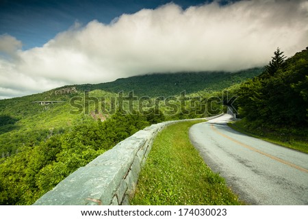 Blue Ridge Parkway in Western North Carolina under storm clouds. - stock photo