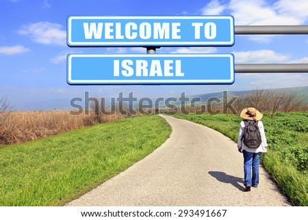 Blue road sign Welcome to Israel against road aspiring to beautiful nature landscape and woman tourist hiking. Hula Valley reserve -stopover for migrating birds. Northern Israel  - stock photo