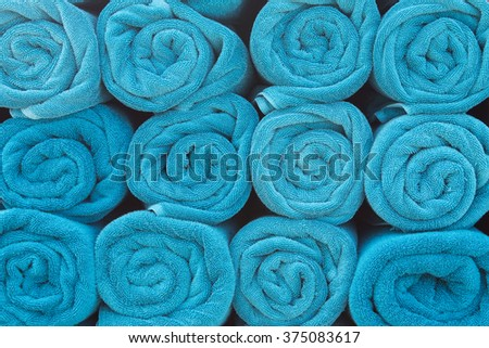 Blue rolled towels. - stock photo