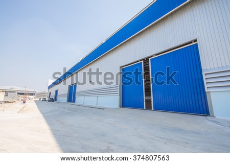 Blue roof and doors Factory warehouse. - stock photo