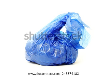 Blue rubbish bag isolated on white - stock photo