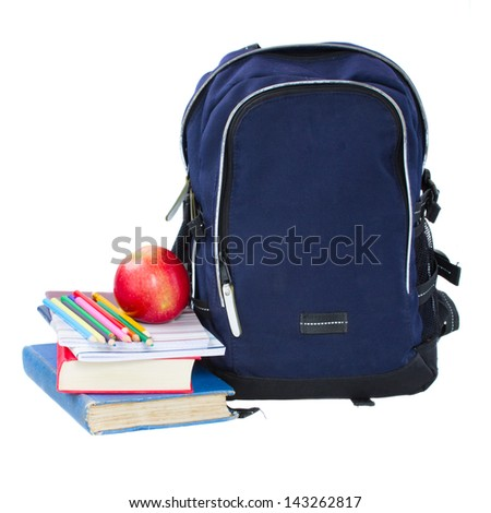 blue school backpack with stationery isolated on white background - stock photo