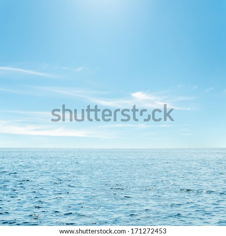 blue sea and clouds in sky over it - stock photo