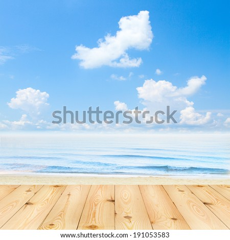 Blue sea and clouds on sky. beach and tropical sea. Empty wooden deck table with tablecloth for product montage. Sunny Day, Blue Sky with Clouds Free space for your text   - stock photo