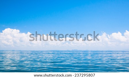 blue sea and clouds on sky (soft focus for background) - stock photo
