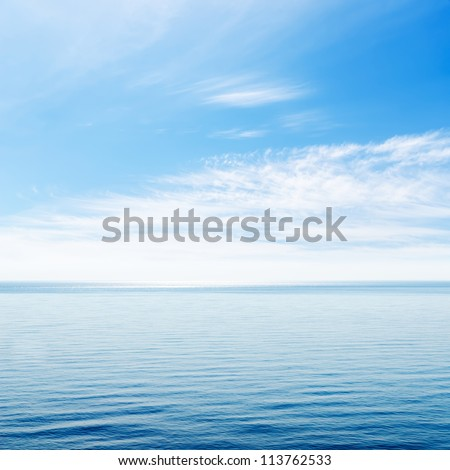 blue sea and cloudy sky over it - stock photo