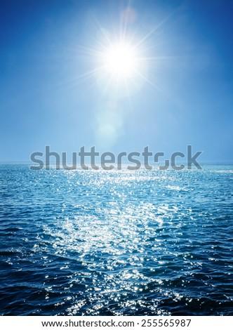 Blue sea and sun - stock photo