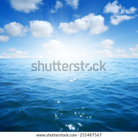 Blue sea and sun on sky - stock photo