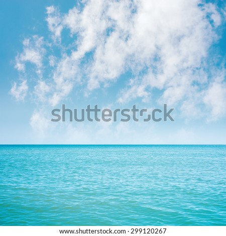 blue sea and white clouds in sky over it - stock photo