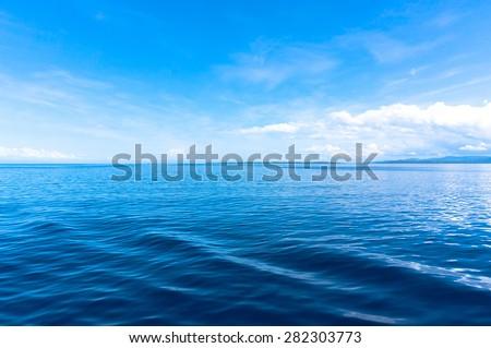blue sea blue sky horizon - stock photo