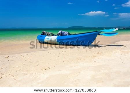 Blue sea kayak on the tropical beach - stock photo