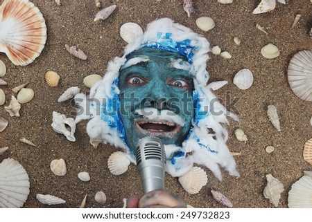 blue sea man holding microphone, voice of the sea concept - stock photo