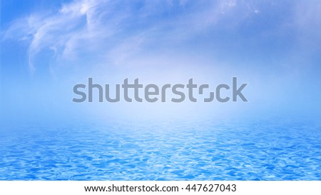 Blue sea, ocean with waves and clear blue sky and clouds - stock photo