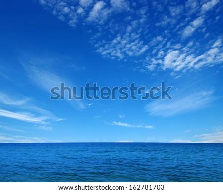 Blue sea  on sky - stock photo