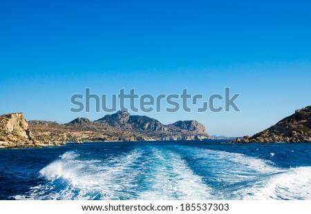Blue sea sky and mountains near Lindos  Rhodes island, Greece. - stock photo
