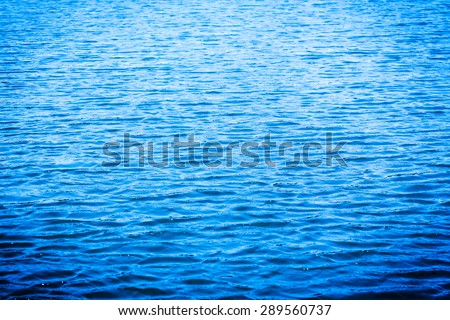 blue sea water surface background with vignette - stock photo