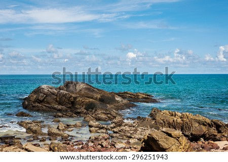 Blue sea with blue sky and shape of rock  - stock photo
