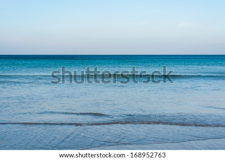 Blue sea with waves and sky without clouds - stock photo