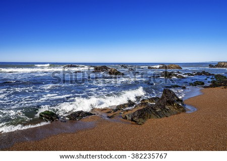 Blue seas & skies, sandy beach, tidal pools, rock and unusual geological formations, at Moonstone Beach. Traveling the Big Sur Highway (Highway 1), California Central Coast, San Luis Obispo County. - stock photo