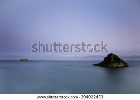 Blue Seascape at Thatcher Rock, Torquay, Devon, UK. - stock photo