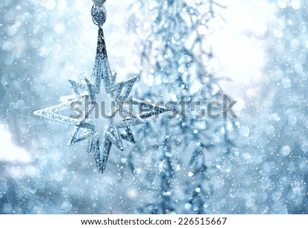 blue shiny star. christmas or new year decoration. abstract background with snow effect - stock photo