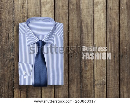 blue shirt on a wooden brown background - stock photo