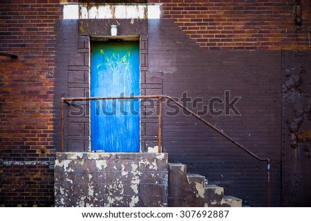 Blue Side Door on old city building. - stock photo