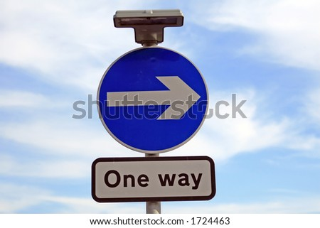 Blue sign with arrow pointing right, directing traffic one way - stock photo