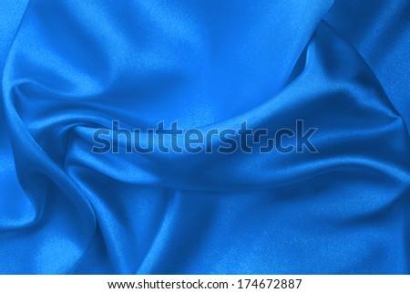 Blue silk fabric background - stock photo
