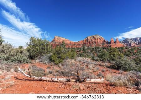 Blue Skies & white clouds in Red Rock Country near Sedona, Arizona. Panoramic vistas. Biking, hiking, & walking trails. Beautiful sunrises & sunsets. Unsurpassed Southwestern landscape colors. - stock photo