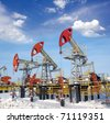 Blue sky above oil field - stock photo