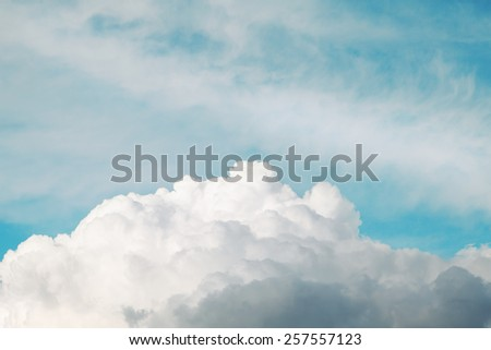 Blue sky and cloud background.Fluffy clouds. - stock photo