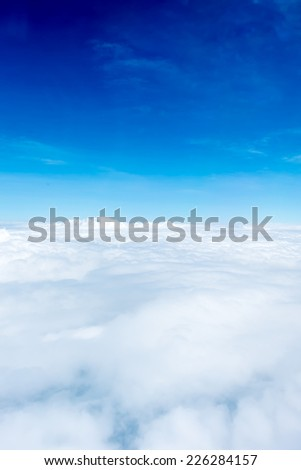 Blue sky and Cloud Top view from airplane window,Nature background - stock photo