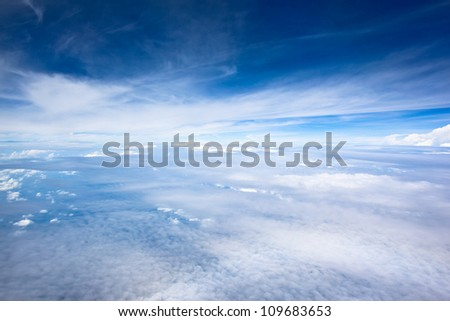 Blue sky and Clouds looking from the Airplane - stock photo