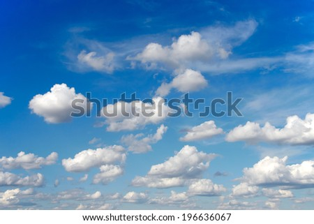 Blue sky and clouds on a sunny summer day - stock photo